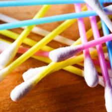 colorful cotton swabs like these should be used to clean around the ears not inside.